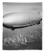 Airship Flying Over New York City Fleece Blanket