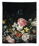 An Overturned Vase Of Flowers Resting On A Ledge Fleece Blanket
