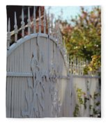 Angled Closeup Of White Washed Iron Gate To Garden Fleece Blanket