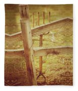 Spading Fork On Chicken Wire Fence Morning Sunlight Fleece Blanket
