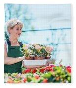 Attractive Gardener Selecting Flowers In A Gardening Center. Fleece Blanket
