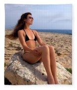 Beautiful Sexy Woman In Bikini Relaxing On A Rocky Seashore Fleece Blanket