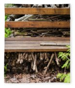 Bench And Wood Pile Fleece Blanket
