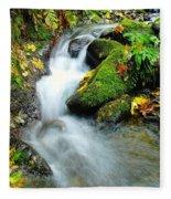 Betwixt The Mossy Rocks Fleece Blanket