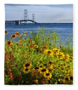 Blooming Flowers By The Bridge At The Straits Of Mackinac Fleece Blanket