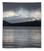 Blue Sky Through Dark Clouds Fleece Blanket