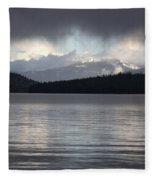Blue Sky Through Dark Clouds Fleece Blanket