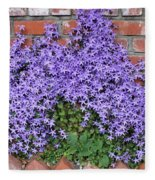 Brick Wall With Blue Flowers Fleece Blanket