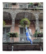 Bubbles Blow From An Ornate Balcony In New Orleans At Mardi Gras Fleece Blanket