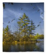 Canada Geese Flying By A Small Island On Hall Lake Fleece Blanket