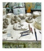Ceramic Objects And Brushes On The Table Fleece Blanket
