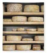Cheese Wheels On Wooden Shelves In The Cheese Store Fleece Blanket