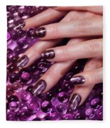 Closeup Of Woman Hands With Purple Nail Polish Fleece Blanket