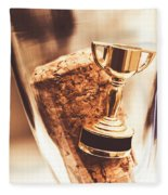 Cork And Trophy Floating In Champagne Flute Fleece Blanket
