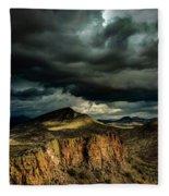 Dark Storm Clouds Over Cliffs Fleece Blanket
