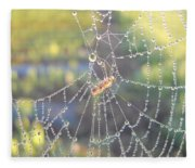 Dew Drops On A Spider Web Fleece Blanket
