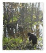 Dog Exploring Mississippi River Bank Fleece Blanket