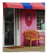Dress Shop With Orange And Blue Awning Fleece Blanket