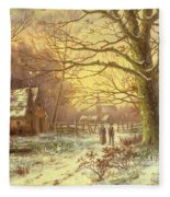 Figures On A Path Before A Village In Winter Fleece Blanket