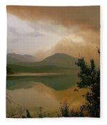 Fire Over St Mary Lake Fleece Blanket