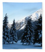 Firs In The Snow Fleece Blanket