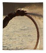 Flyboarder Doing Back Flip Over Backlit Waves Fleece Blanket