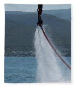 Flyboarder In Silhouette Balancing High Above Water Fleece Blanket