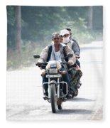 Four People On A Motorbike Fleece Blanket