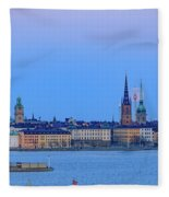 Full Moon Rising Over The Trio Of Gamla Stan Churches In Stockholm Fleece Blanket