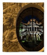 Illuminated Night View - Beautiful Revival House Through A Fence Window Fleece Blanket