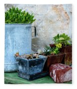 Gardening Pots And Small Shovel Against Stone Wall In Primosten, Croatia Fleece Blanket