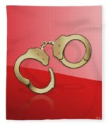 Gold Handcuffs On Red Fleece Blanket