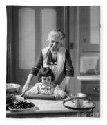 Grandmother And Granddaughter Baking Fleece Blanket
