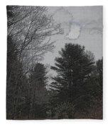 Gray Skies Over The Pines Fleece Blanket