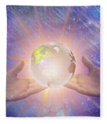 Hands With A Glowing Earth Fleece Blanket