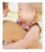 Happy Mother Holding Baby With Look Of Surprise Fleece Blanket