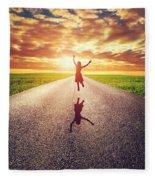 Happy Woman Jumping On Long Straight Road Fleece Blanket
