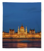 Hungarian Parliament Building At Night In Budapest Fleece Blanket