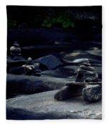 Inuksuk Stone Figures And River Fleece Blanket