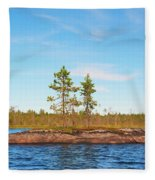 Island In The Form Of A Smooth Rock With Several Pines Fleece Blanket
