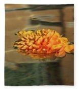 Jewel Drops - Orange Chrysanthemum Bloom Floating In A Fountain Fleece Blanket