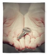 Key In Woman's Hand In Gesture Of Giving. Concept Of Success In Live, Business Solution, Real Estate Etc Fleece Blanket