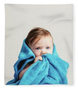 Little Baby Girl Tucked In A Cozy Blue Blanket. Fleece Blanket