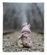 Little Teddy Bear Sitting In Knitted Scarf And Cap In The Winter Forest Between The Rails Fleece Blanket