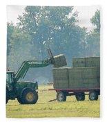 Loading Hay At Dusk Fleece Blanket