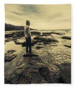 Man Gazing Out On Coastal Rocks Fleece Blanket