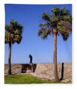 Man With A Hat On The Wall With Palm Trees In Saint Augustine Fl Fleece Blanket