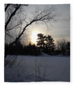 March Sunrise Behind Pines Fleece Blanket
