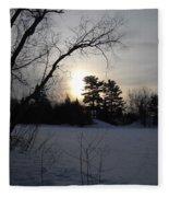 March Sunrise Behind Pines Fleece Blanket