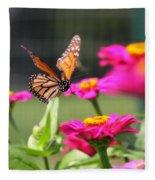 Monarch Approaching Zinnia 2 Fleece Blanket